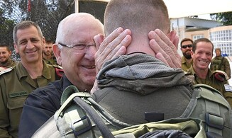 President Rivlin given surprise birthday party at IDF visit