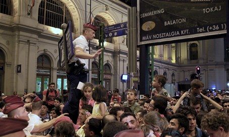 Refugees inundate a train station in Budapest