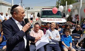 Lawrence philanthropists donate new ambulance to Beit El