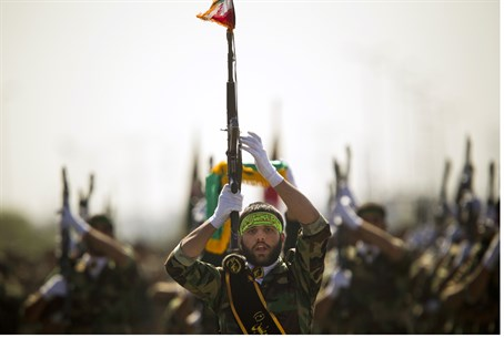 Members of Iran's Basij Force march (file)