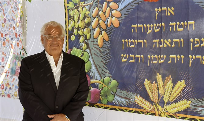 Ambassador Friedman in his sukkah